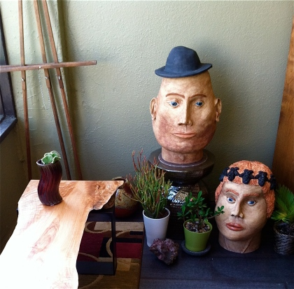 Monumental heads by Claudia Riedener. Live-edge table by Jeff Libby and Adrienne Wicks.