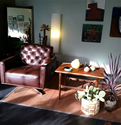 Mid-century cool. Leather swivel chair and teak side table.