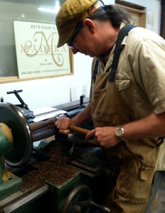 Big wheel keeps on turning: Taylor-Swanson at the lathe.