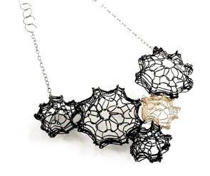 Sterling silver, oxidized steel and gold-filled necklace by Jennifer Bennett. Photo courtesy of the artist