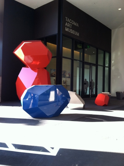A faceted sculptural work by Julie Speidel adds wow to TAM's garage entrance.
