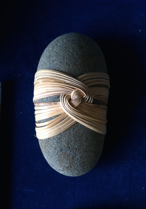 Cane-wrapped river rock by Marcia Mahaffey.